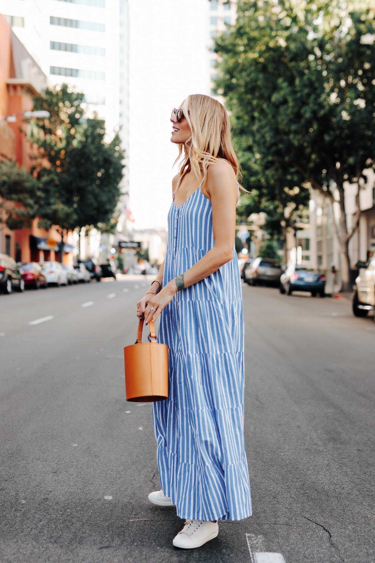 Fashion Jackson Wearing Sezane Blue White Stripe Maxi Dress White Sneakers Cognac Bucket Bag 6