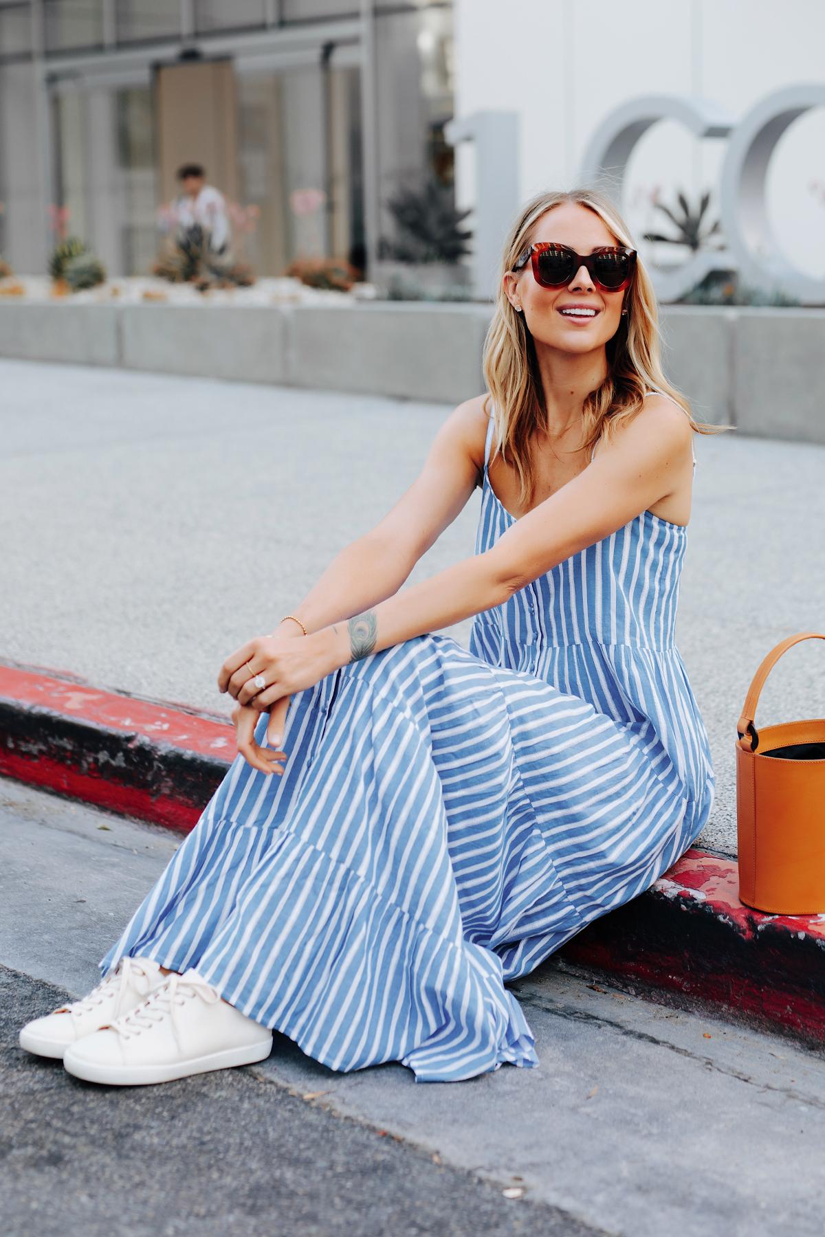 Fashion Jackson Wearing Sezane Blue White Stripe Maxi Dress White Sneakers Cognac Bucket Bag