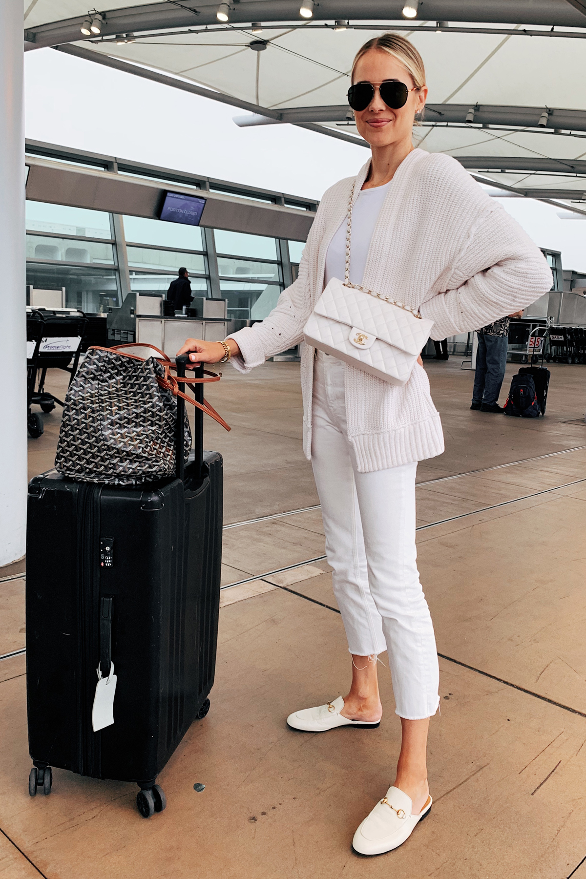 Fashion Jackson Wearing White Cardigan White Bodysuit White Cropped Jeans White Gucci Mules White Chanel Handbag Calpak Luggage Goyard Tote Travel Outfit Airport Outfit