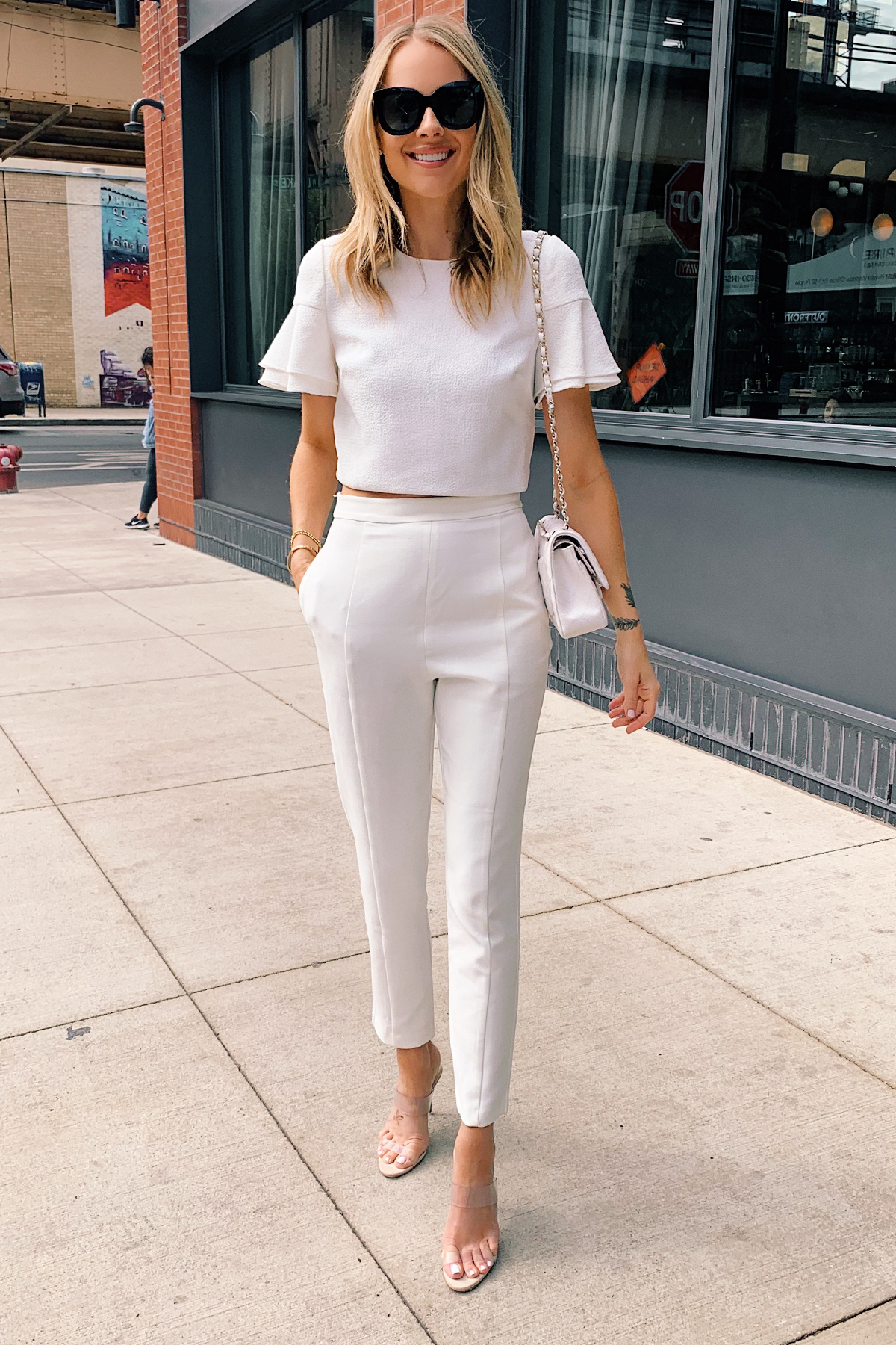 Fashion Jackson Wearing White Two Piecee Jumpsuit Clear Heels White Chanel Handbag Bachelorette Outfit
