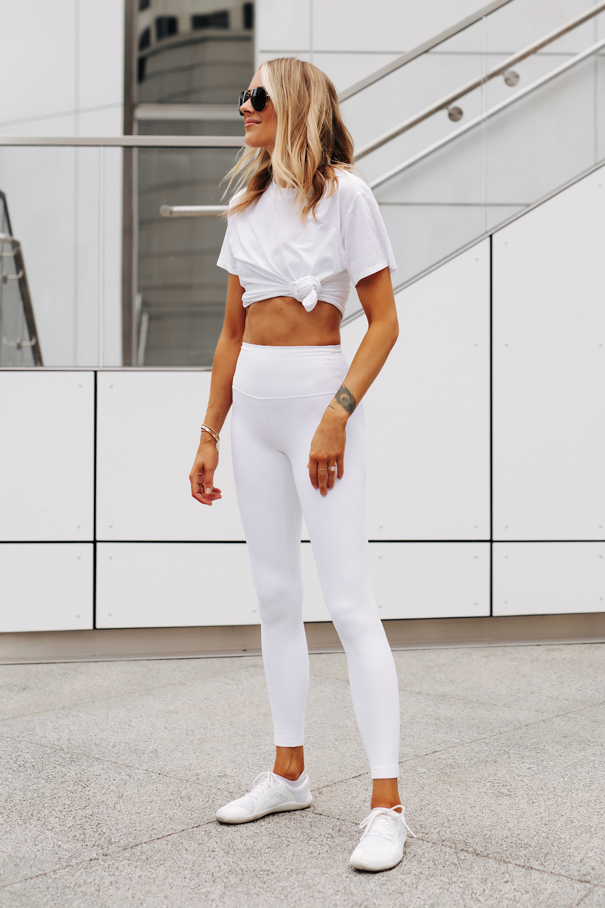 Fashion Jackson Wearing lululemon White Tshirt lululemon White Align Leggings White Sneakers