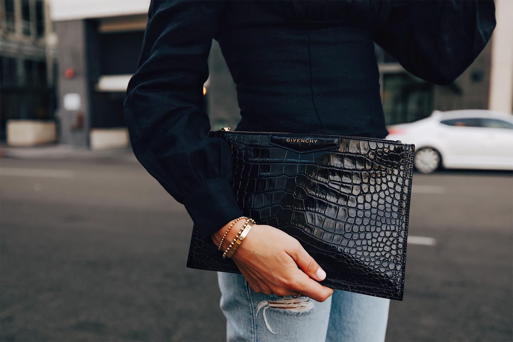 Fashion Jackson Holding Givenchy Antigona Small Black Clutch