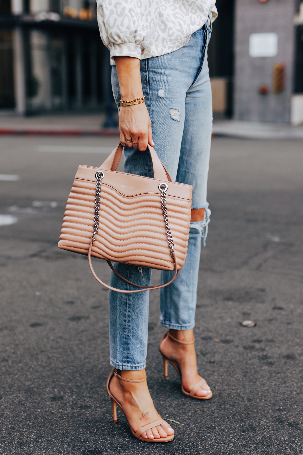 Fashion Jackson Holding Rebecca Minkoff MAB Quilted Satchel Blush Ripped Denim Jeans Tan Ankle Strap Heeled Sandals