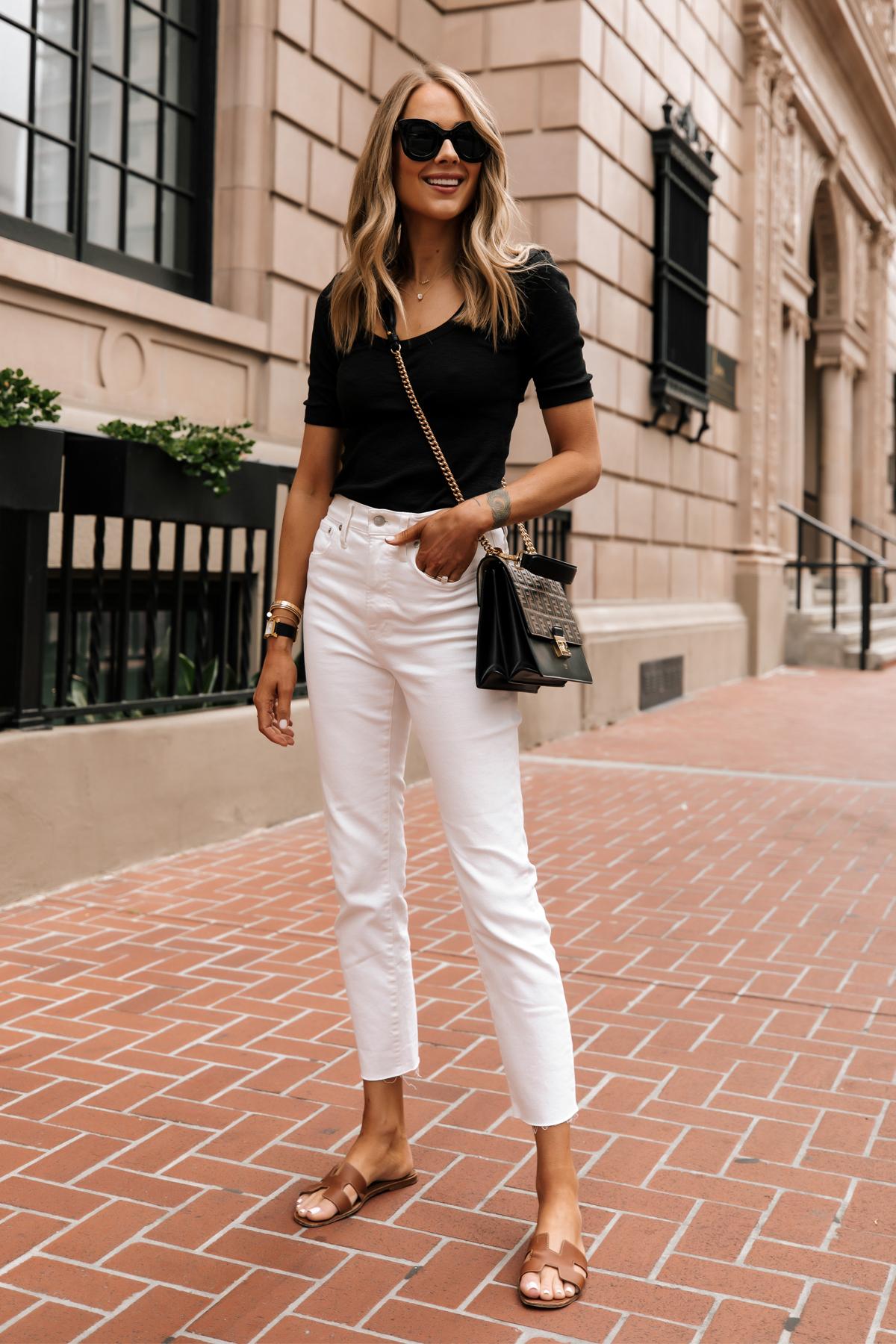Fashion Jackson Wearing Black Scoop Neck Top White Jeans Fendi Ken U Medium Shoulder Bag Hermes Oran Tan Sandals white jeans summer outfit 1