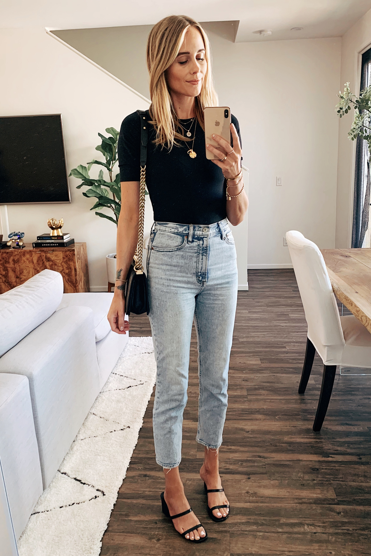 Fashion Jackson Wearing Everlane Black Bodysuit Abercrombie High Rise Jeans Black Sandals