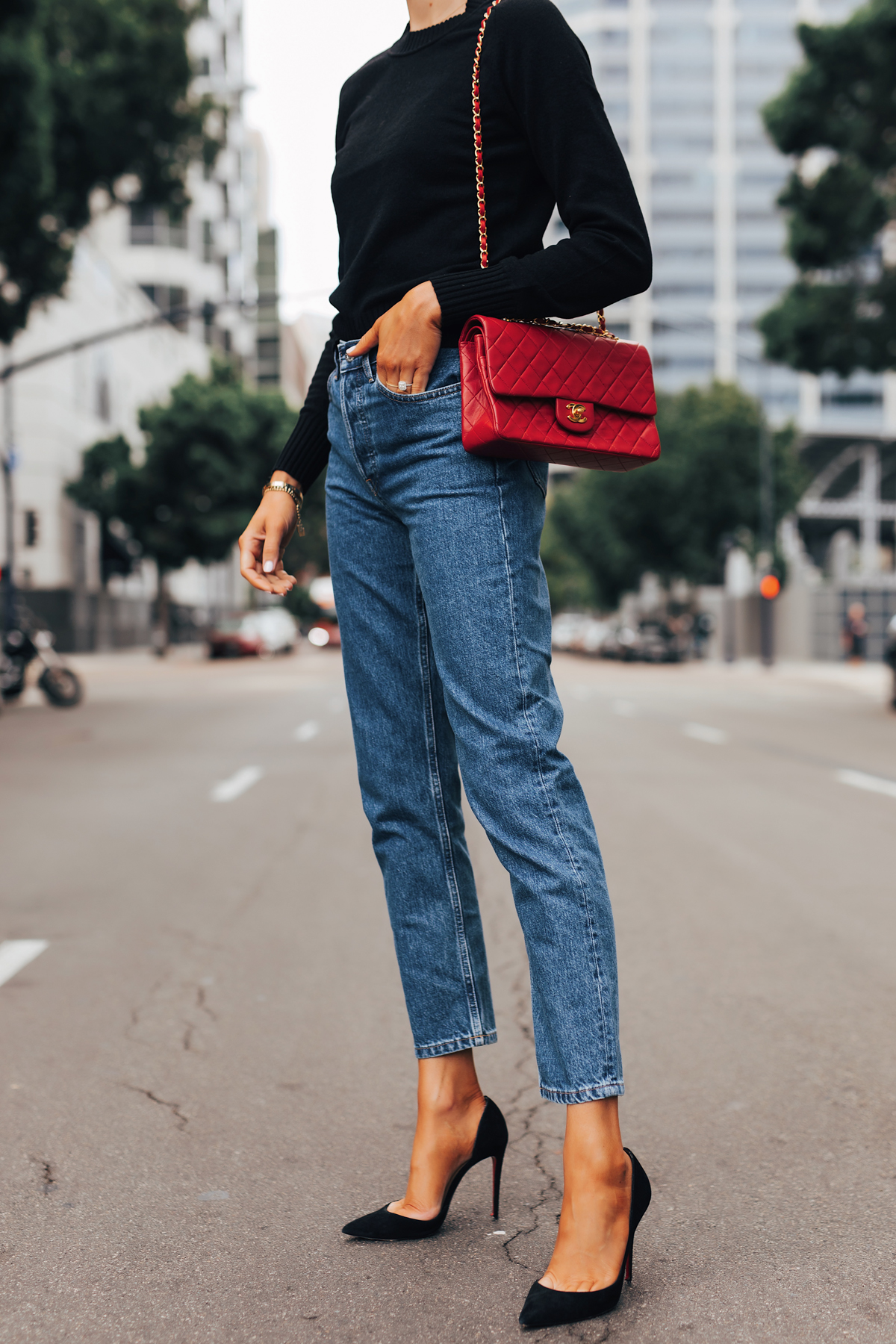 Fashion Jackson Wearing Everlane Black Cashmere Sweater Everlane Relaxed Jeans Black Pumps Chanel Red Handbag 1