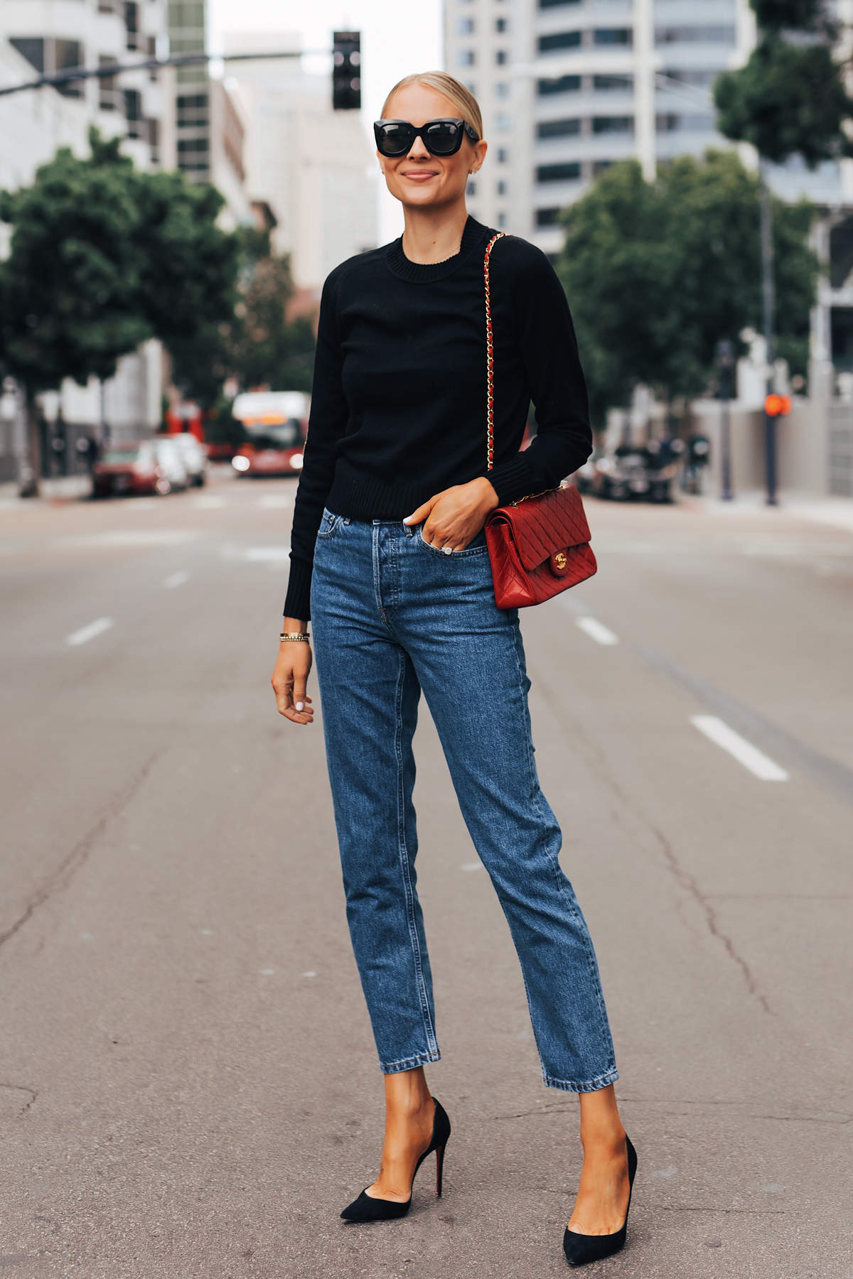 Fashion Jackson Wearing Everlane Black Cashmere Sweater Everlane Relaxed Jeans Black Pumps Chanel Red Handbag 2