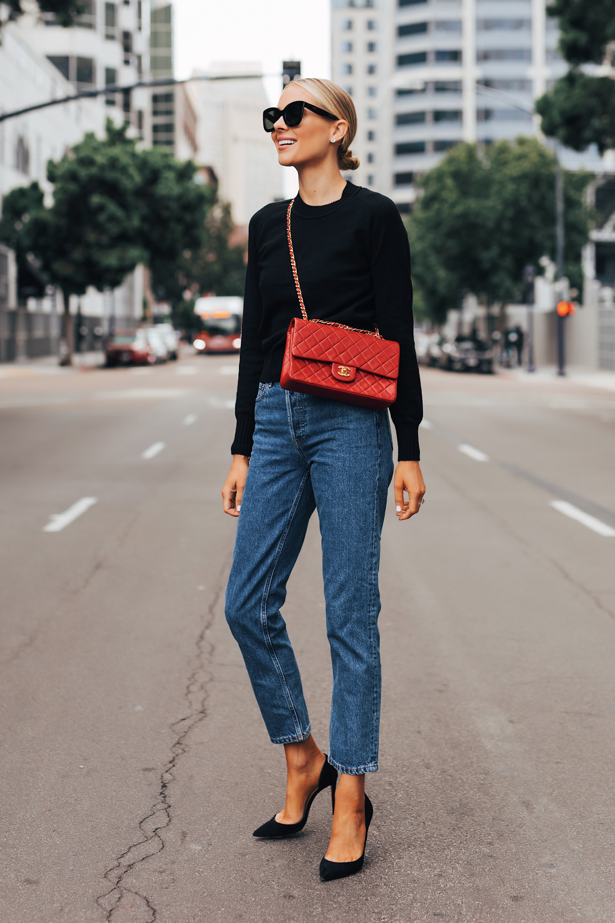 Fashion Jackson Wearing Everlane Black Cashmere Sweater Everlane Relaxed Jeans Black Pumps Chanel Red Handbag