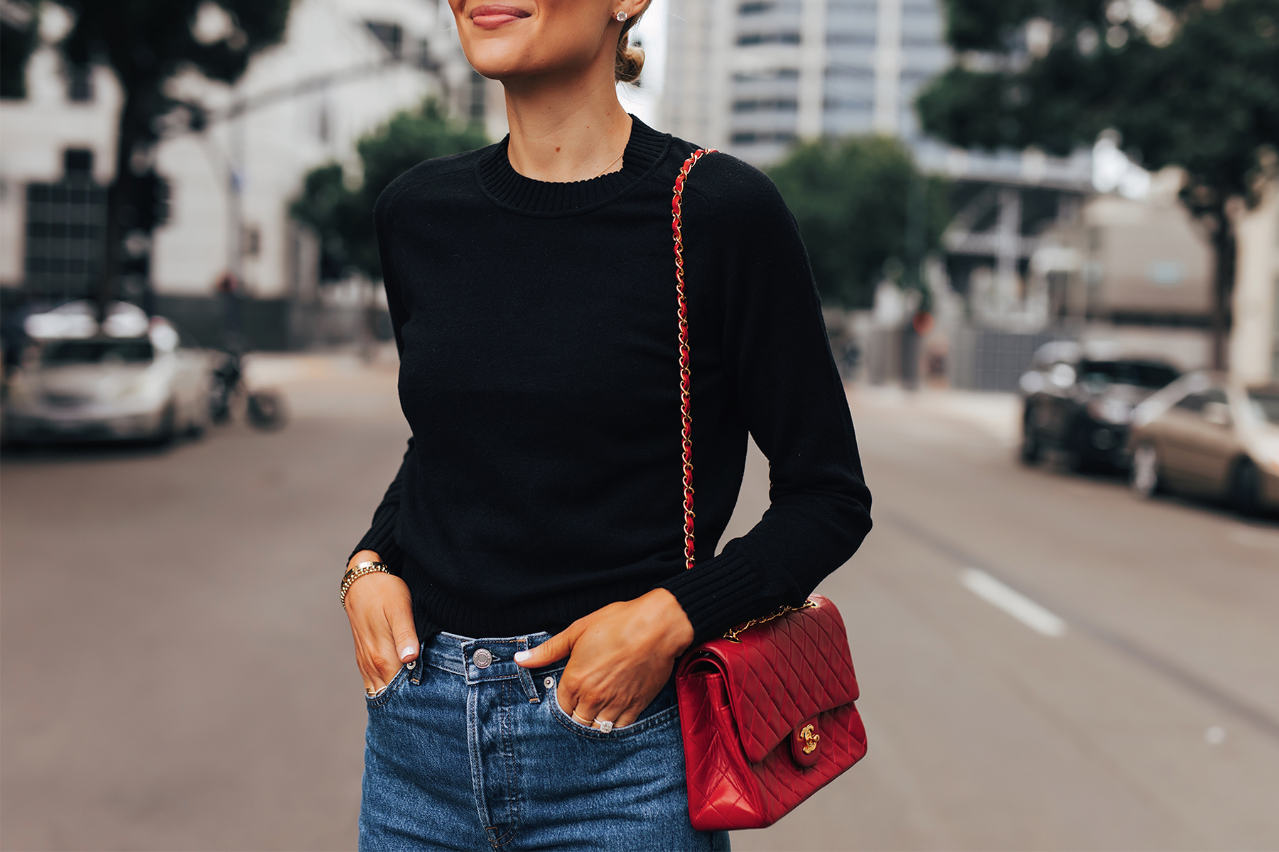 Fashion Jackson Wearing Everlane Black Cashmere Sweater Everlane Relaxed Jeans Chanel Red Handbag 1
