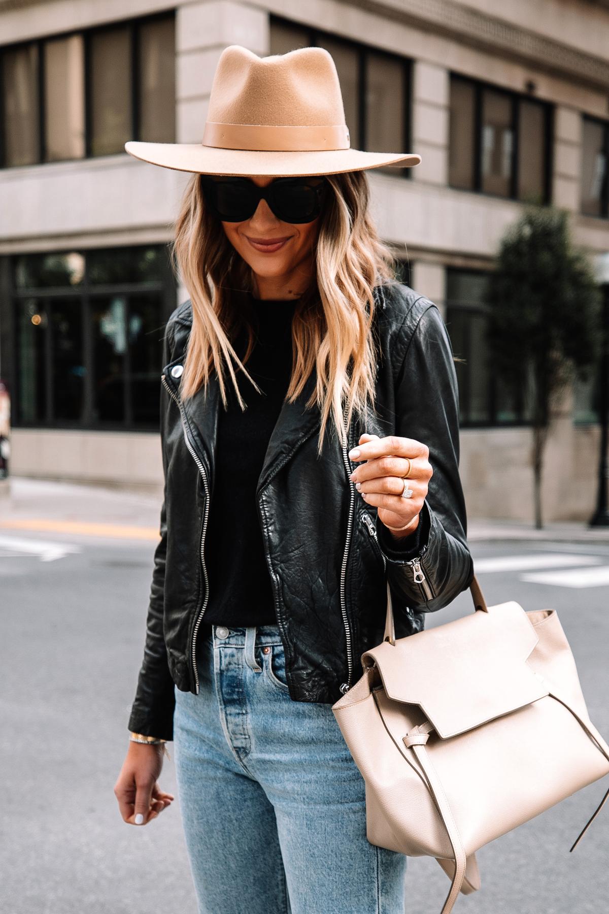 Fashion Jackson Wearing Madewell Black Leather Jacket Black Sweater Levis Jeans Rag and Bone Fall Hat Celine Belt Bag