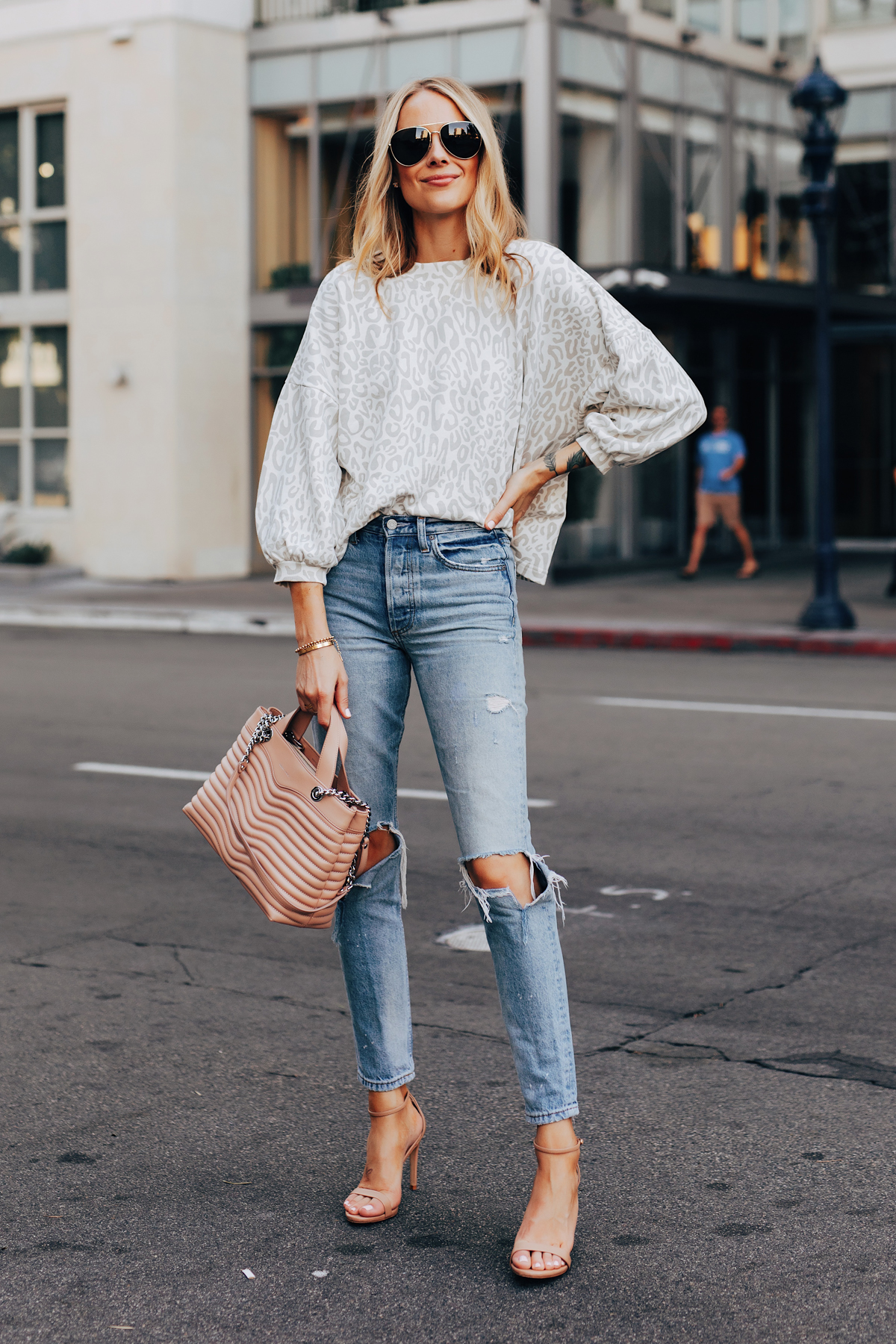 Fashion Jackson Wearing Rebecca Minkoff Leopard Sweatshirt Ripped Jeans Tan Ankle Strap Heeled Sandals Aviator Sunglasses Rebecca Minkoff MAB Quilted Satchel Blush