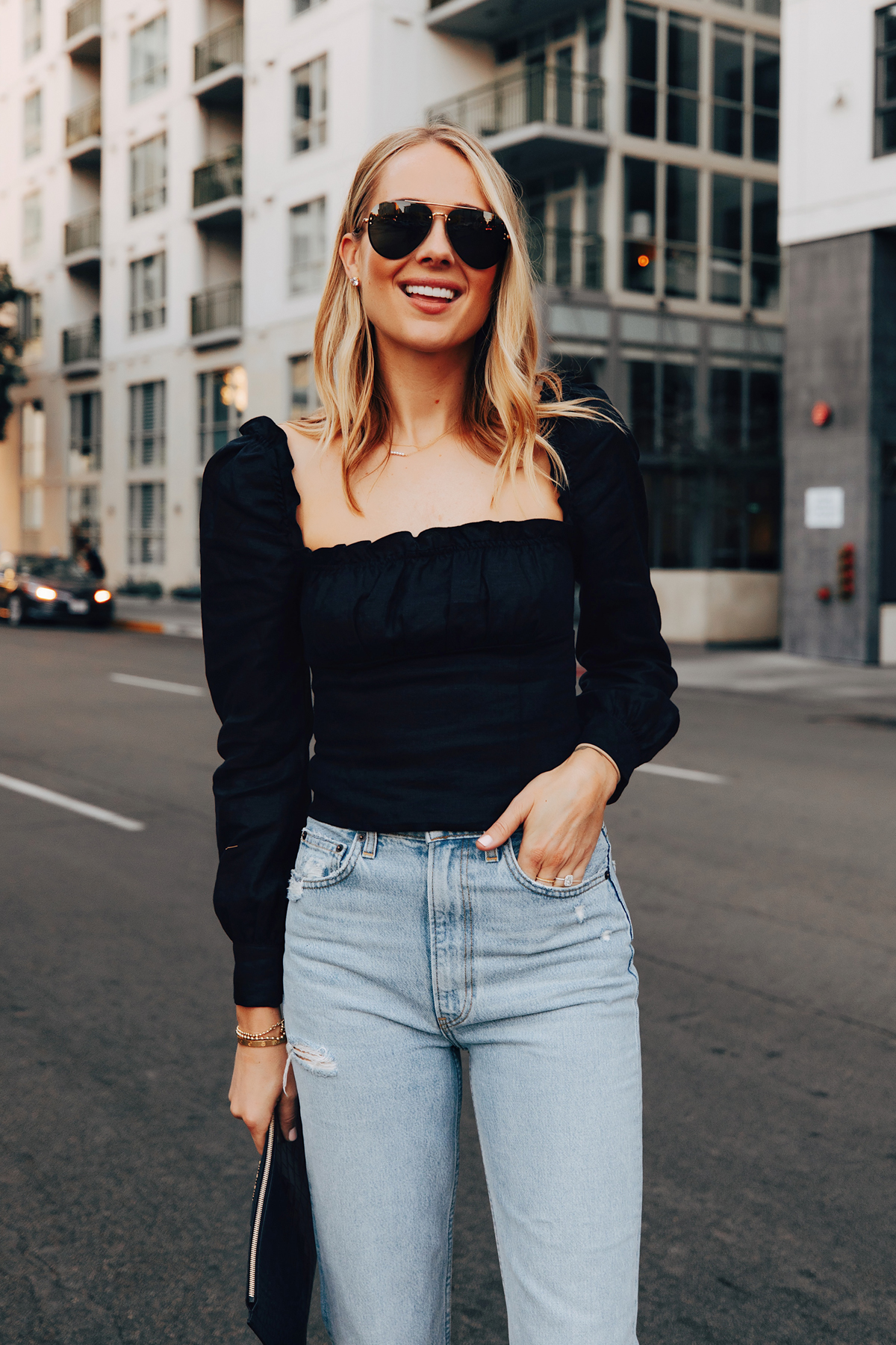 Fashion Jackson Wearing Reformation Black Puff Sleeve Top Reformation Jeans
