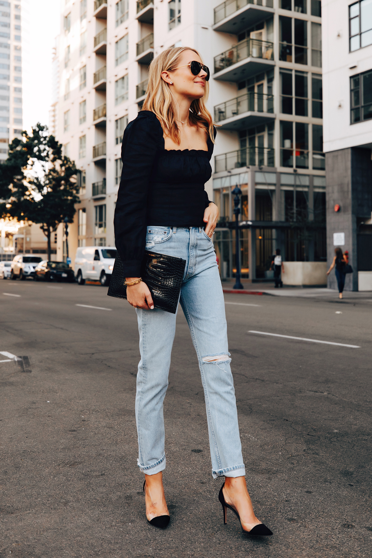 Fashion Jackson Wearing Reformation Black Puff Sleeve Top Reformation Ripped Jeans Gianvito Rossi Black Plexi Pumps Givenchy Antigona Black Clutch