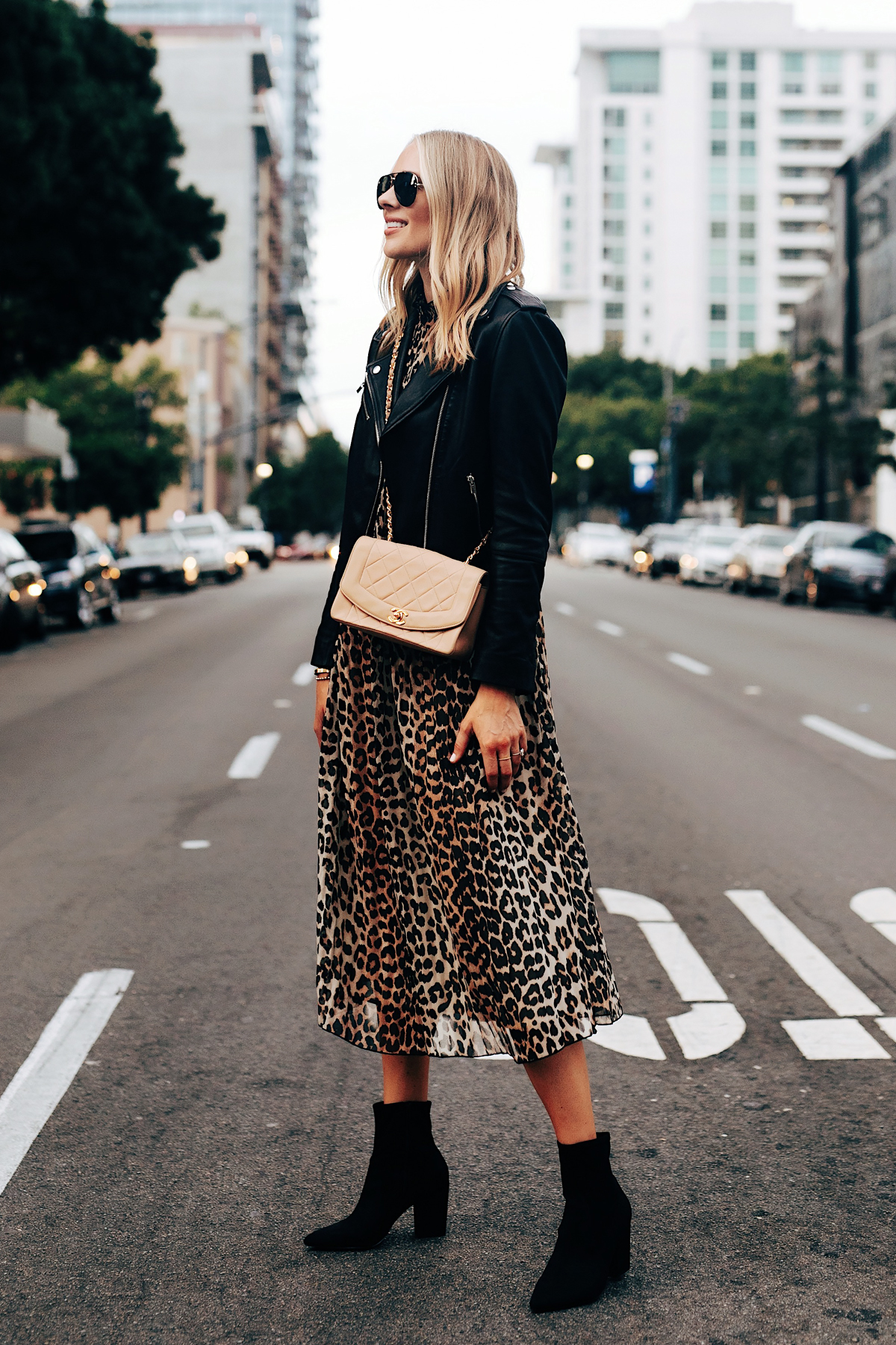 Fashion Jackson Ganni Leopard Midi Dress Club Monaco Black Leather Jacket Black Booties Tan Chanel Handbag