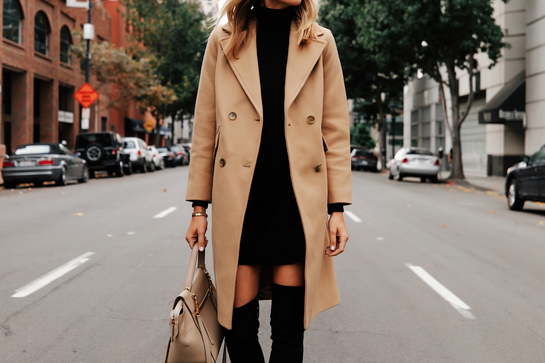 Fashion Jackson Wearing Everlane Camel Coat Black Sweater Dress