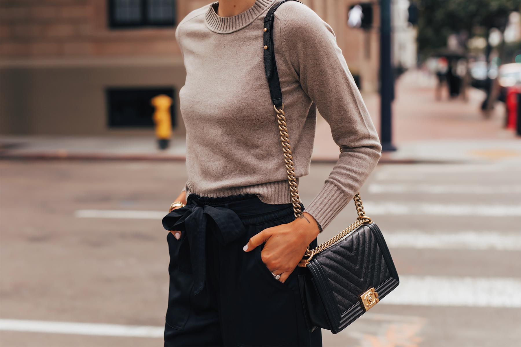 Fashion Jackson Wearing Everlane Taupe Cashmere Sweater Black Tie Waist Pants Chanel Black Boy Bag
