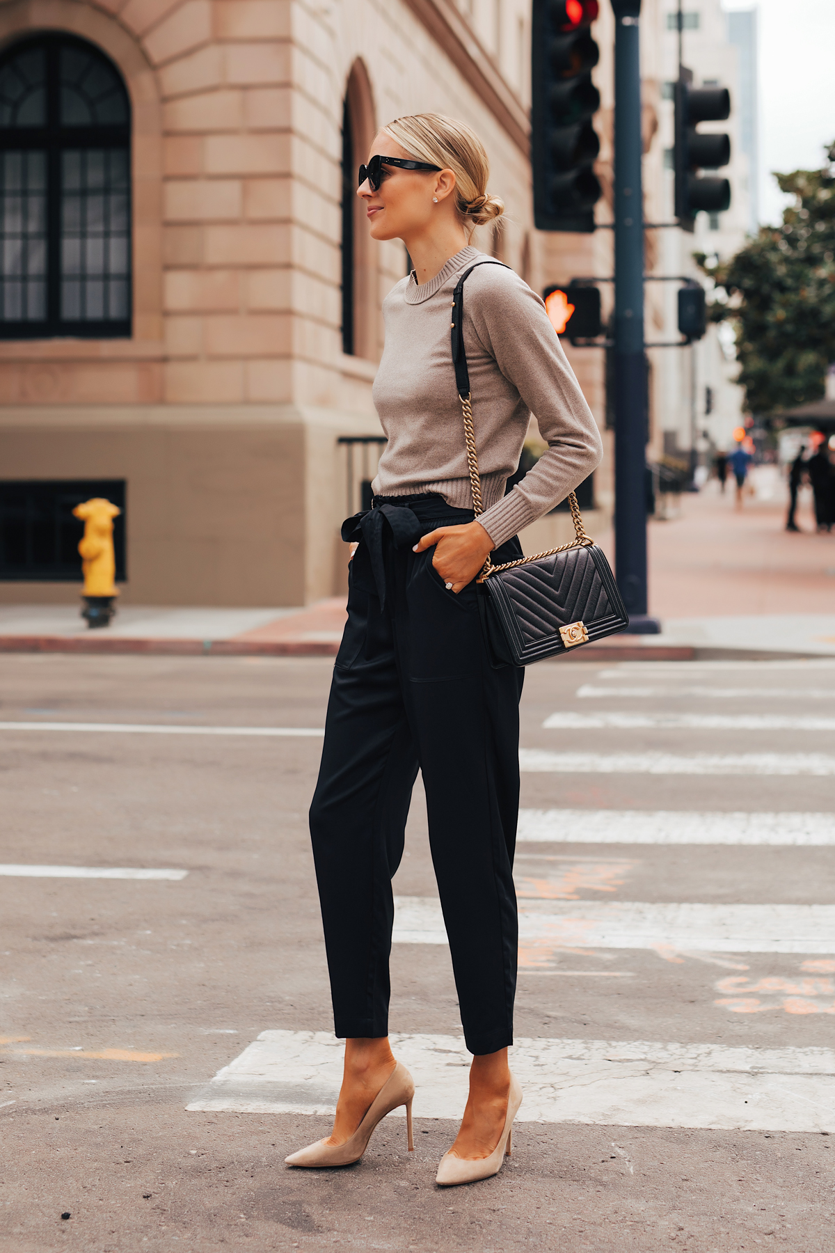 Fashion Jackson Wearing Everlane Taupe Cashmere Sweater Black Tie Waist Pants Jimmy Choo Nude Pumps Chanel Black Boy Bag