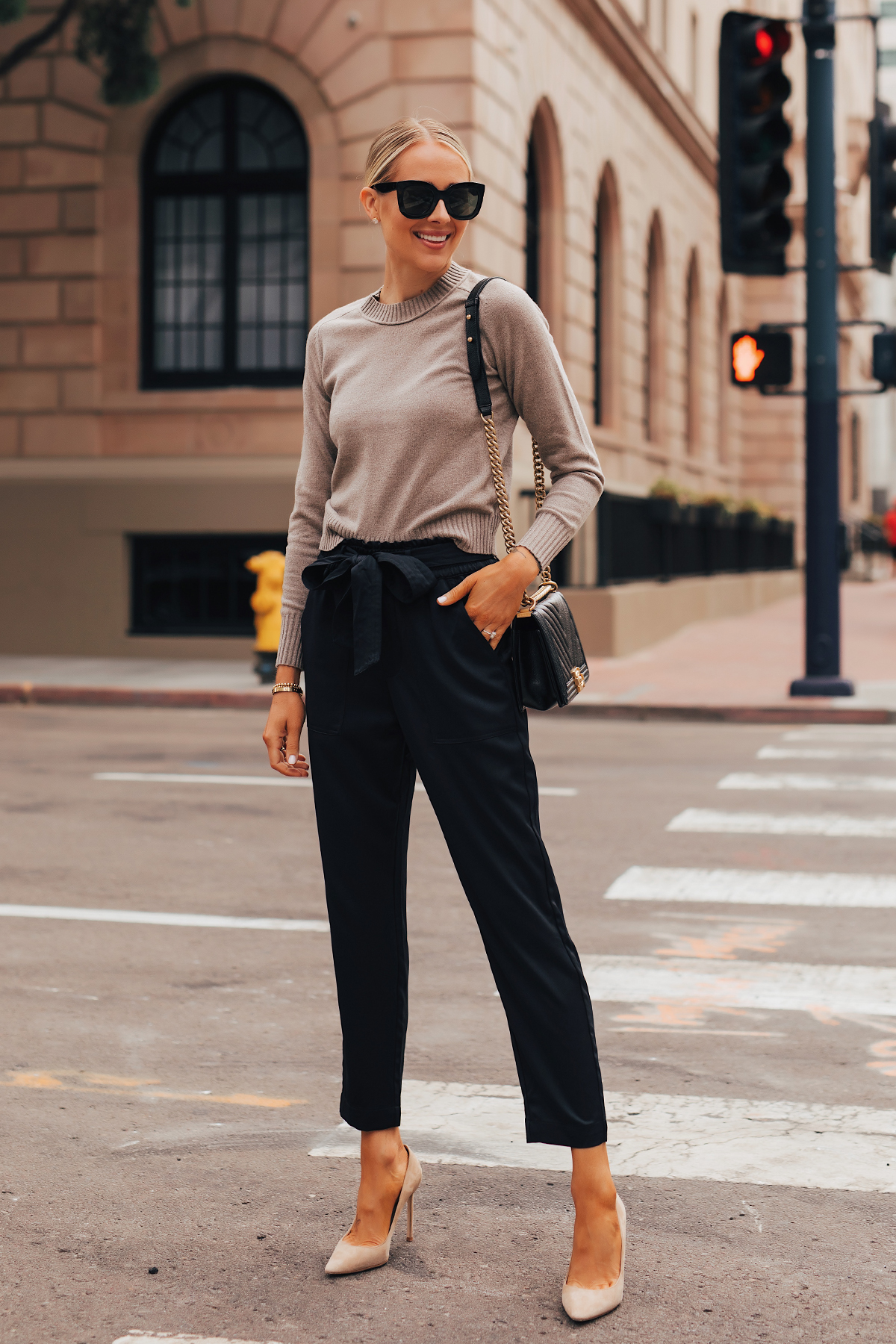 Fashion Jackson Wearing Everlane Taupe Cashmere Sweater Black Tie Waist Pants Nude Pumps Chanel Black Boy Bag 1