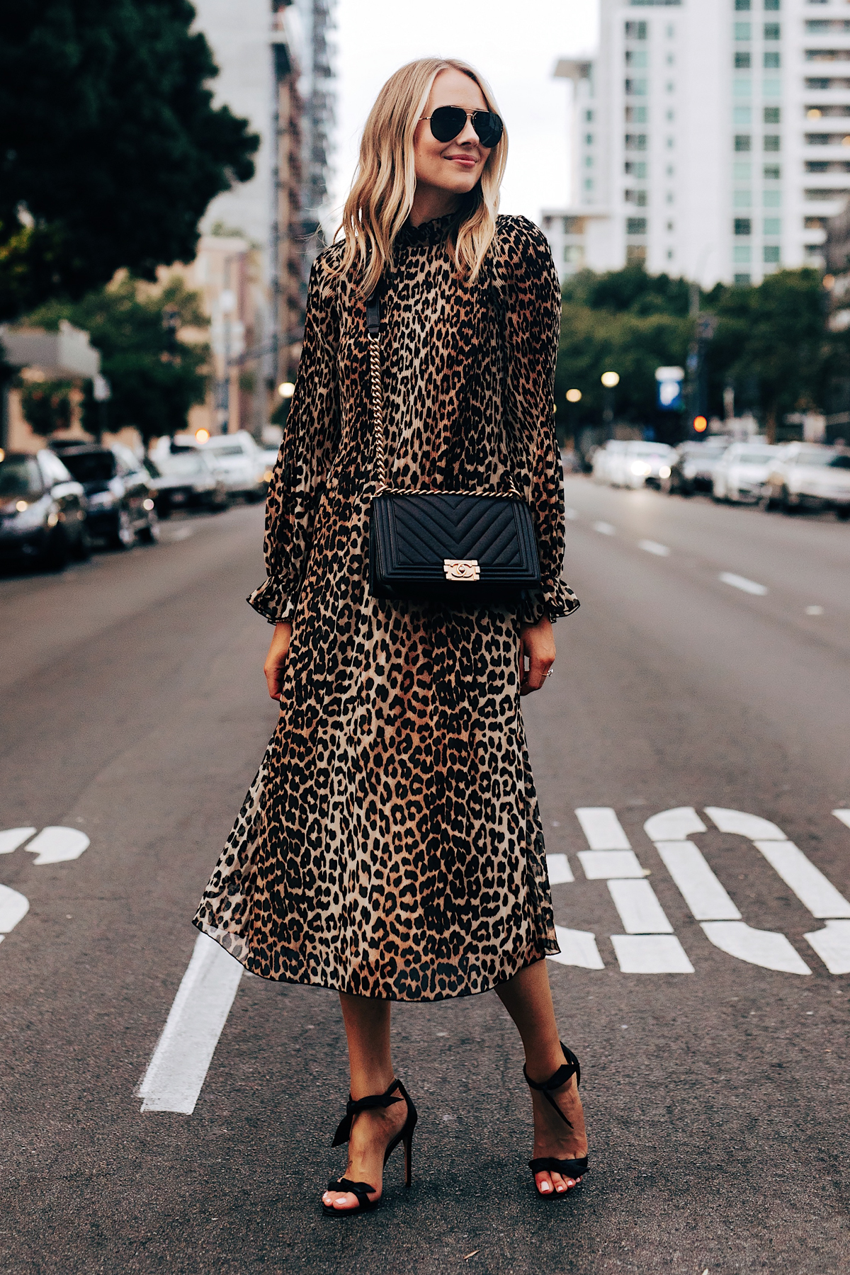 Fashion Jackson Wearing Ganni Leopard Midi Dress Alexandre Birman Clarita Black Heels Chanel Black Boy Bag