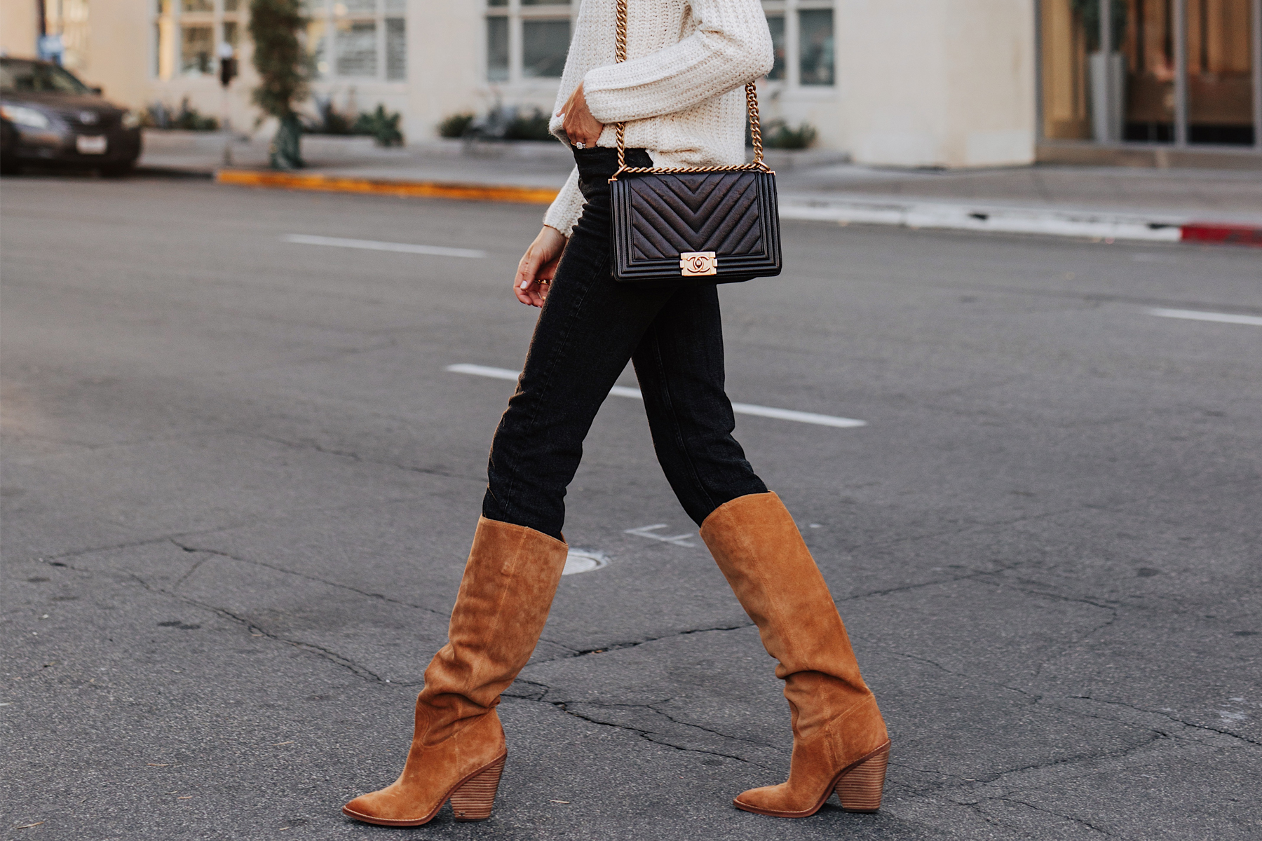 Fashion Jackson Wearing White Sweater Black Jeans Sam Edelman Tan Suede Knee High Boots Chanel Black Boy Bag
