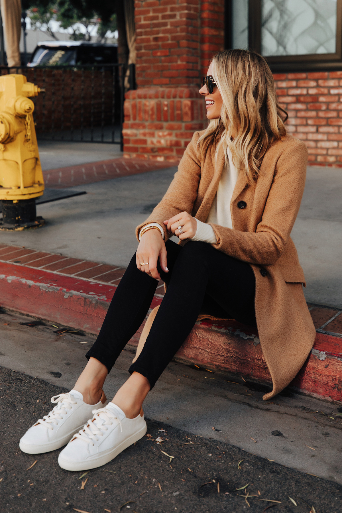 Fashion Jackson Wearing Ann Taylor Camel Coat Black Skinny Jeans White Sneakers