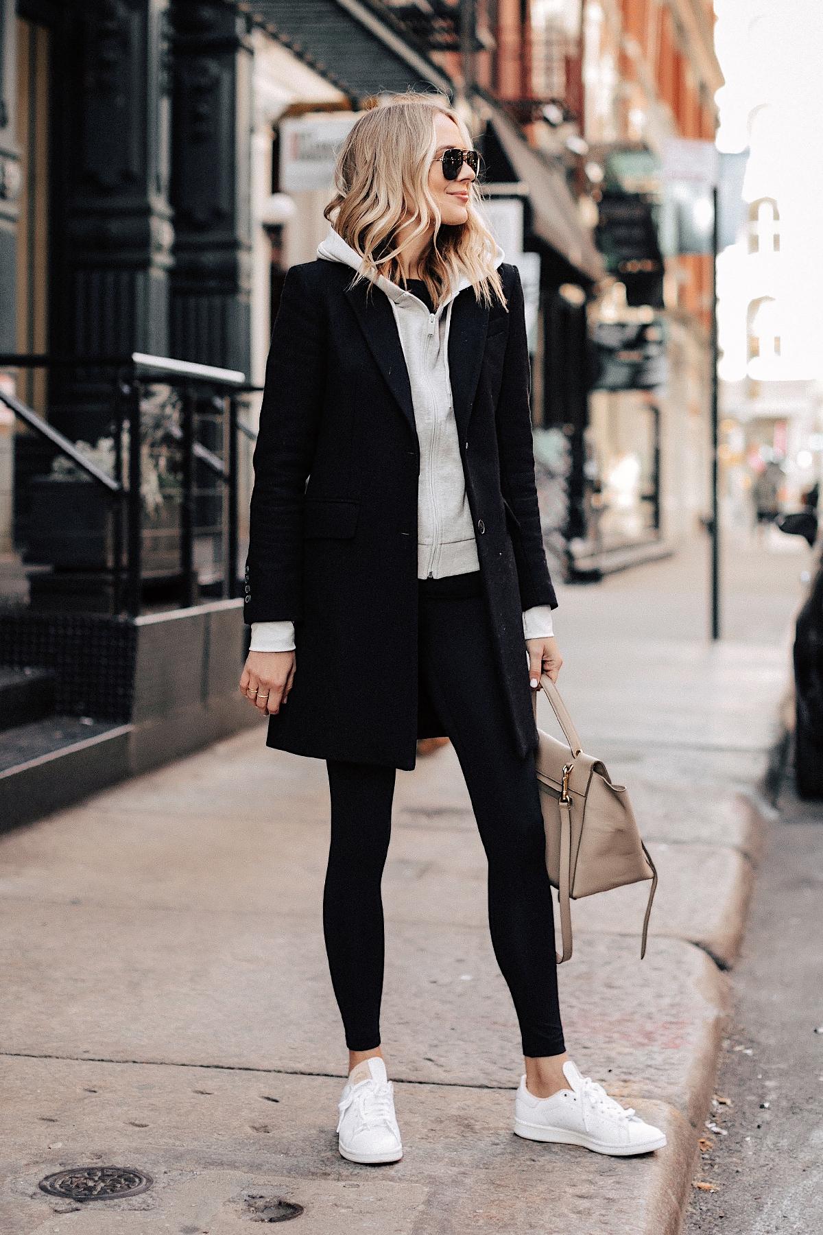 Fashion Jackson Wearing Black Wool Coat Grey Hoodie Black Leggings adidas white Stan Smith Sneakers NYC Street Style 2