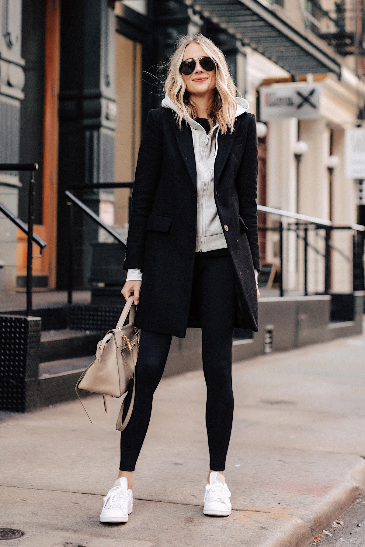 Fashion Jackson Wearing Black Wool Coat Grey Hoodie Black Leggings adidas white Stan Smith Sneakers New York Street Style