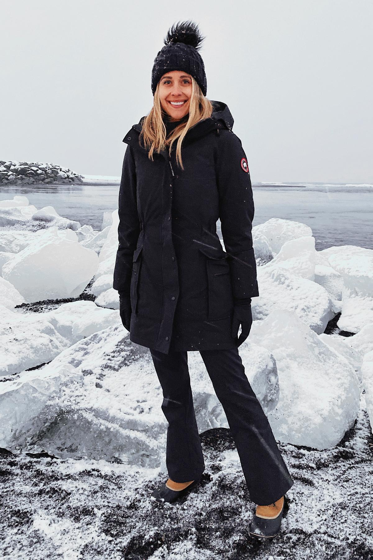 Fashion Jackson Wearing Canada Goose Black Jacket Black Winter Pants Sorel Winter Boots Black Beanie Diamond Beach Iceland Itinerary Travel Guide