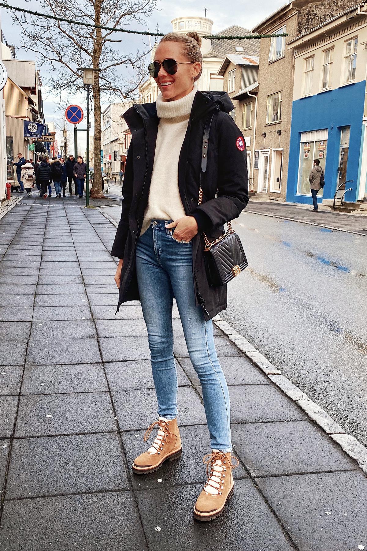 Fashion Jackson Wearing Canada Goose Black Jacket White Sweater Winter Boots Iceland Itinerary Travel Guide