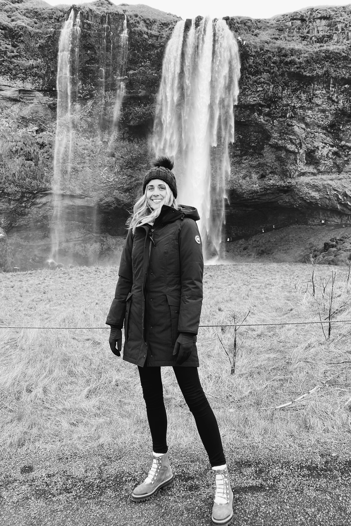 Fashion Jackson Wearing Canada Goose Black Jacket Winter Boots Black Beanie Waterfall Iceland Itinerary Travel Guide