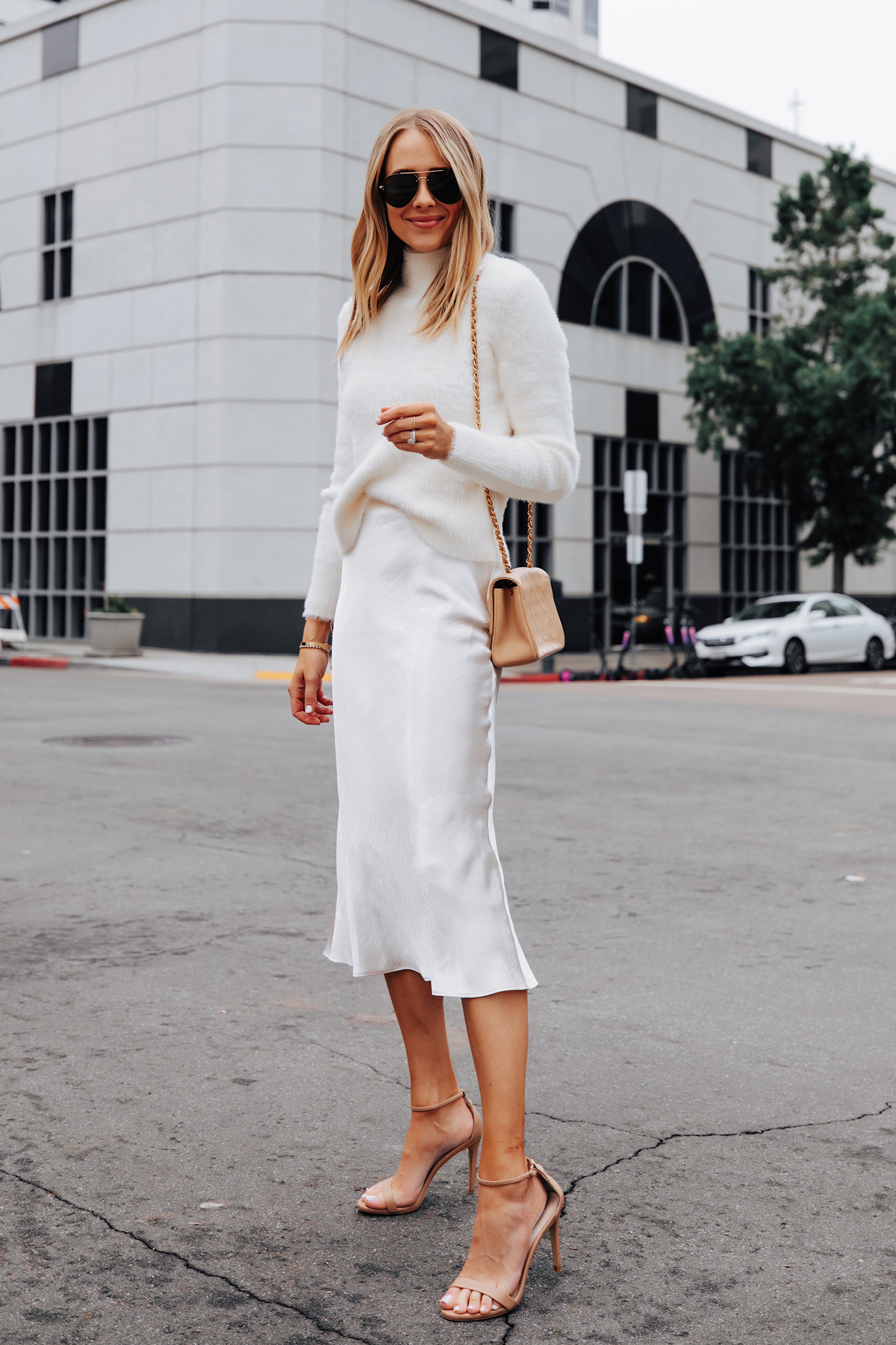 Fashion Jackson Wearing Banana Republic White Fuzzy Sweater White Slip Midi Skirt Winter White Party Outfit.jpg
