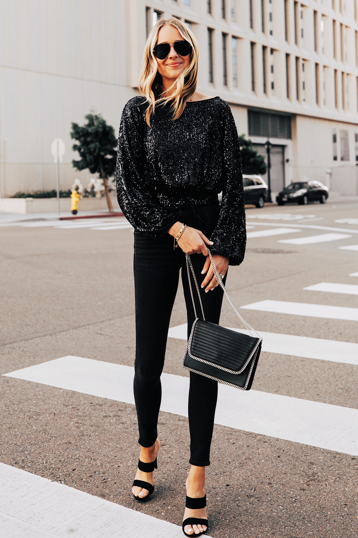 Fashion Jackson Wearing Black Sequin Top Black Jeans Black Heeled Sandals