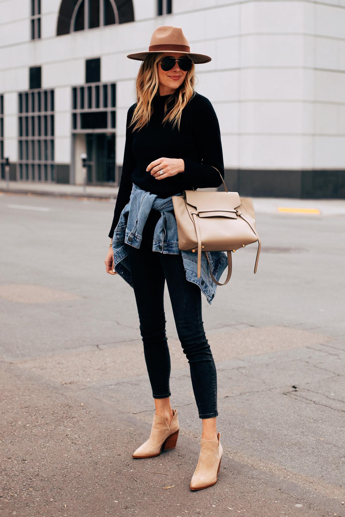 Fashion Jackson Wearing Black Sweater Black Skinny Jeans Denim Jacket Tan Booties Tan Wide Brim Hat Celine Mini Belt Bag