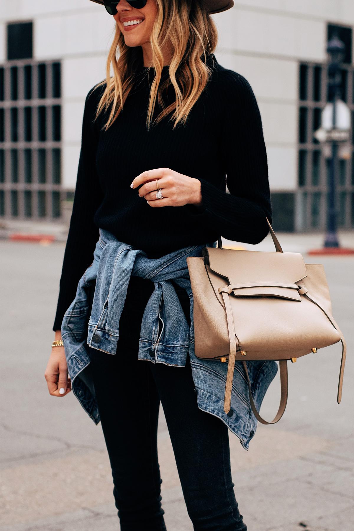 Fashion Jackson Wearing Black Sweater Black Skinny Jeans Denim Jacket Tied Around Waist Celine Mini Belt Bag