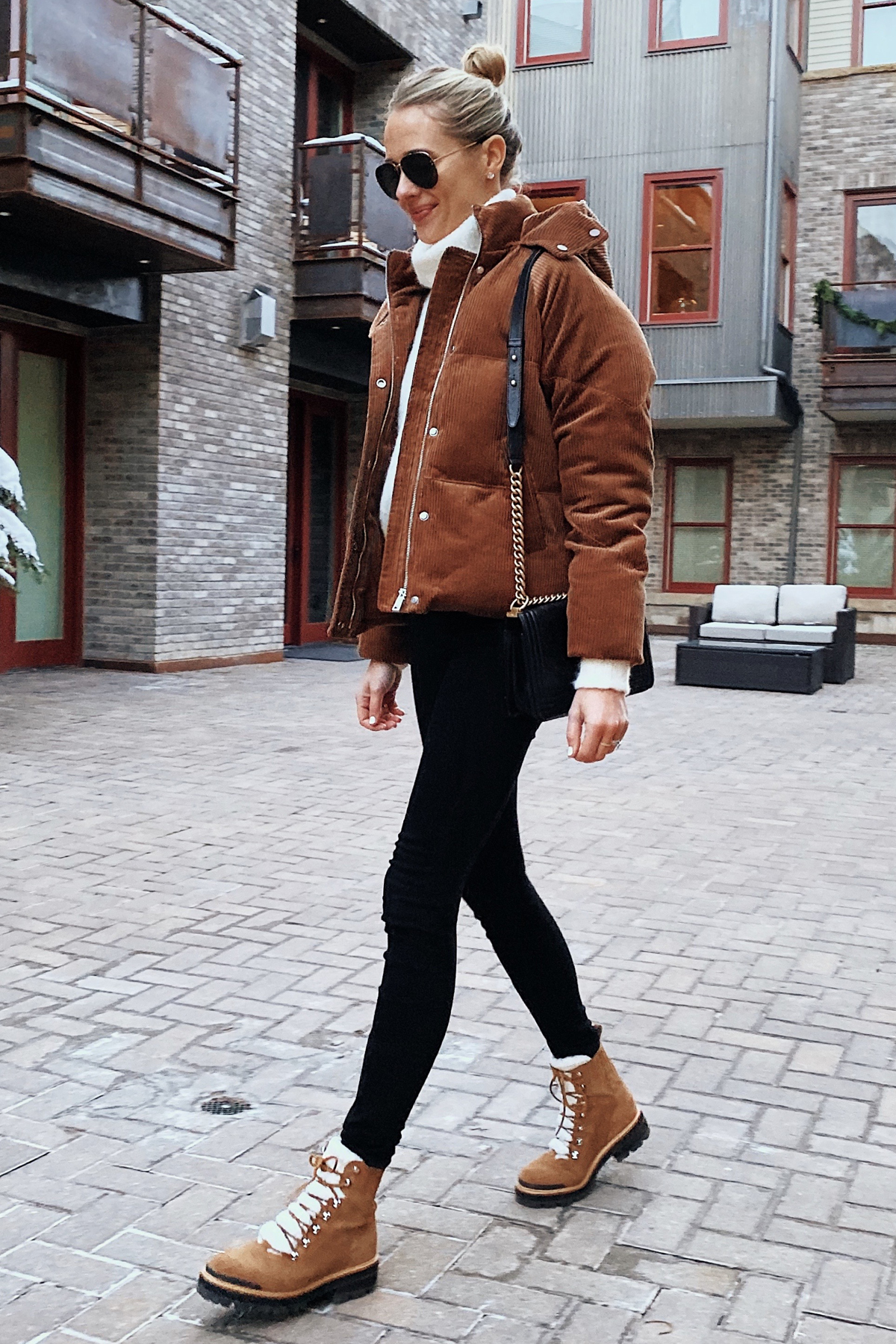 Fashion Jackson Wearing Brown Puffer Jacket Winter Boots Ski Trip Outfit