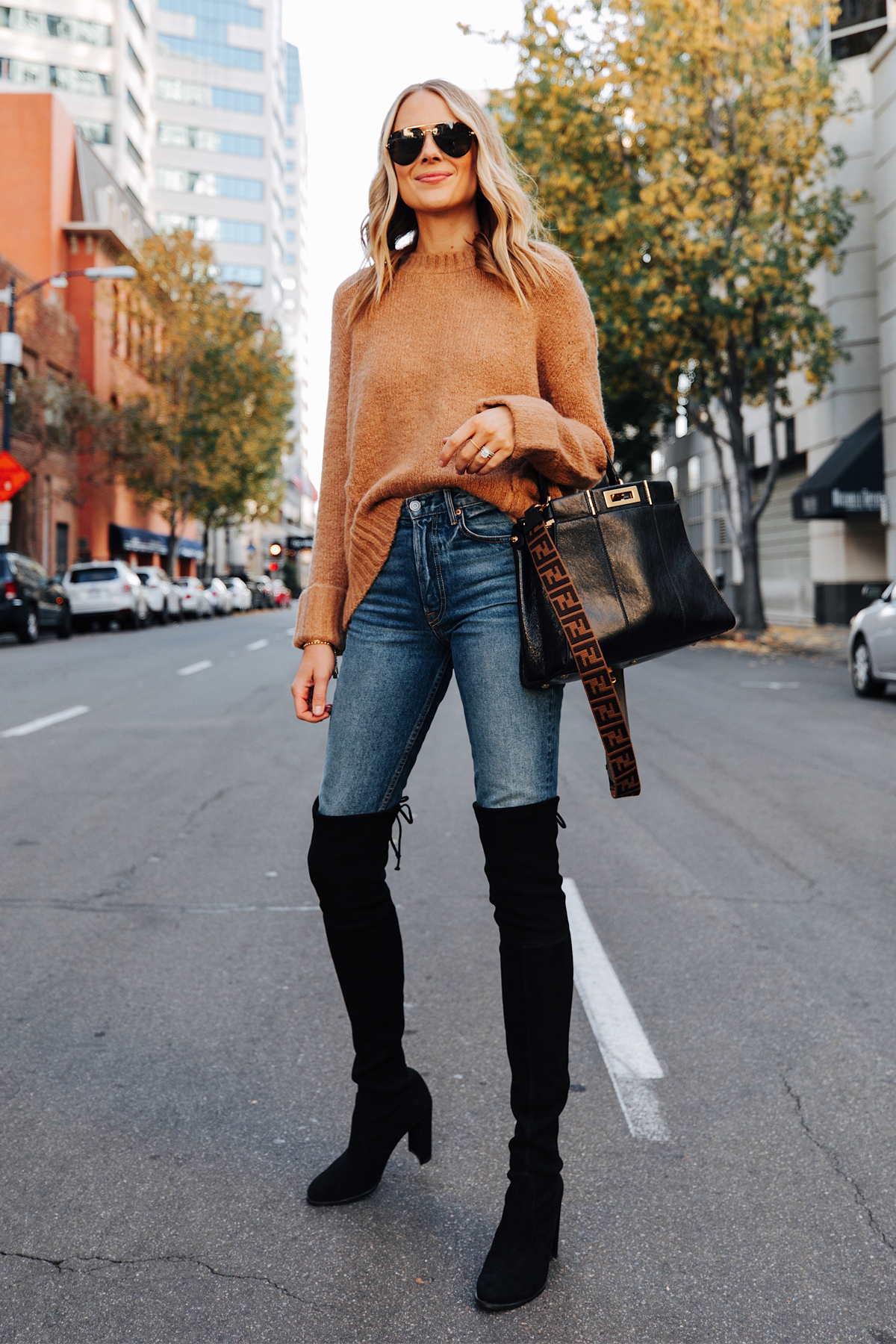 Fashion Jackson Wearing Camel Sweater Stuart Weitzman Black Over the Knee Boots Fendi Peekaboo Black Handbag 1