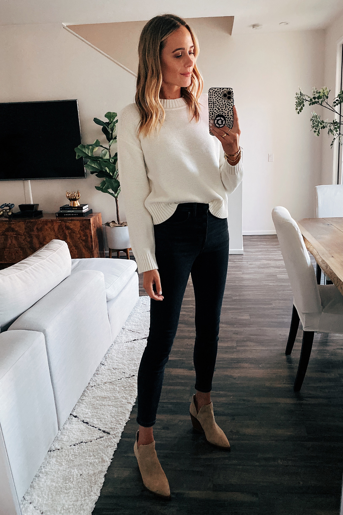 Fashion Jackson Wearing Everlane Linkstitch Crewneck White Sweater Black Skinny Jeans