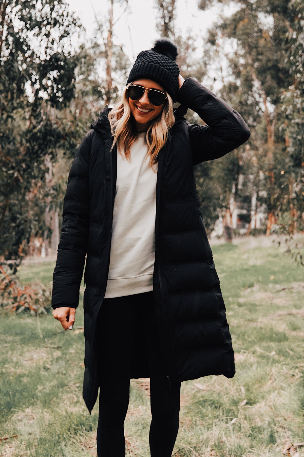 Fashion Jackson Wearing lululemon Black Sleet Street Long Jacket Black Beanie
