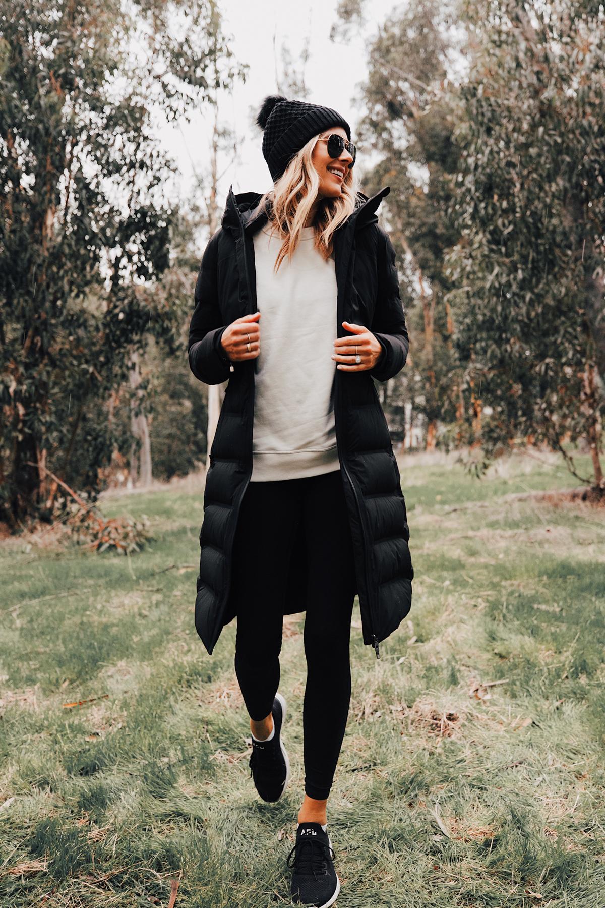 Fashion Jackson Wearing lululemon Black Sleet Street Long Jacket Black Beanie Black Leggings hikes in San Diego