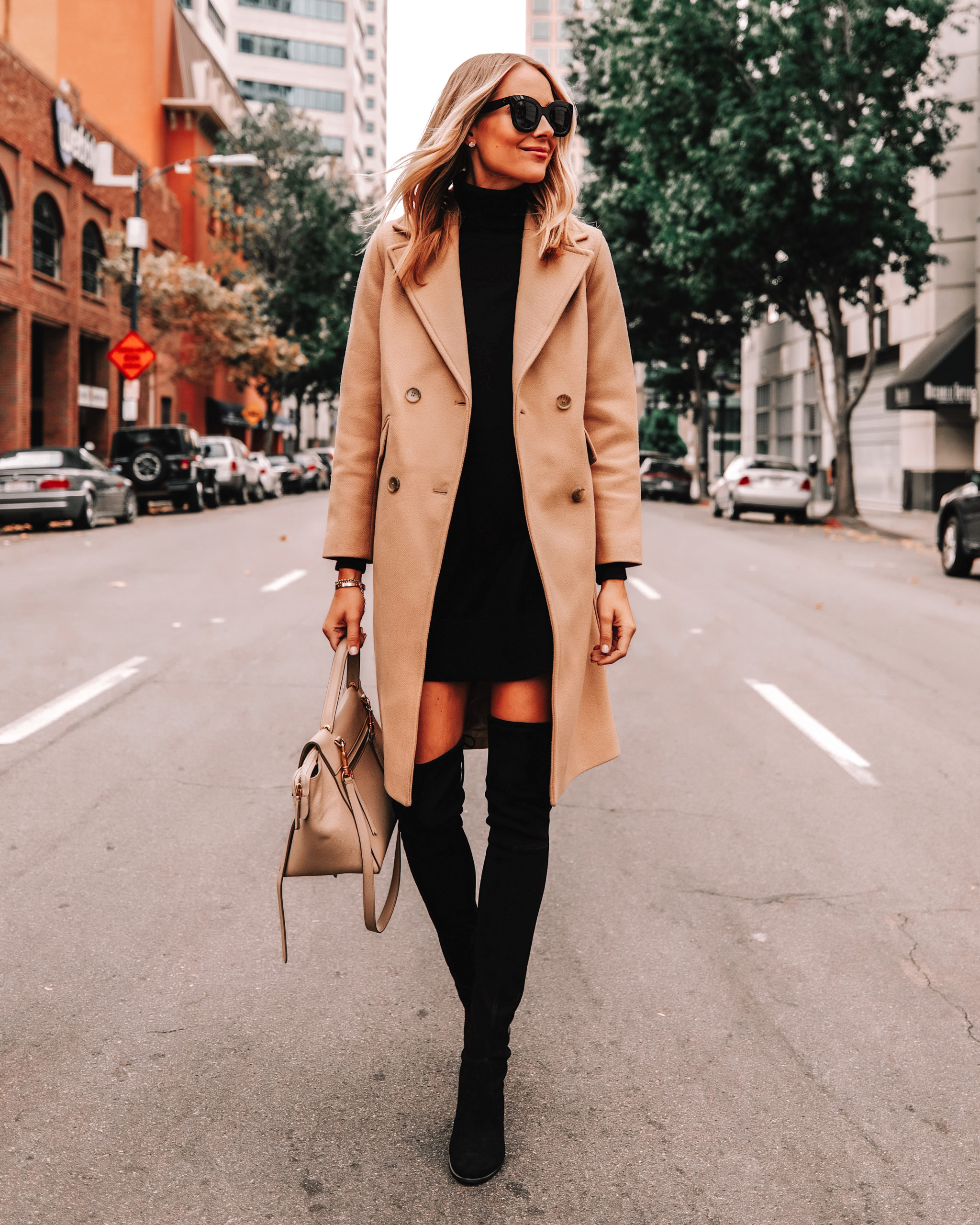 Fashion Jackson Wearing Everlane Camel Coat Black Sweater Dress Black OTK Boots