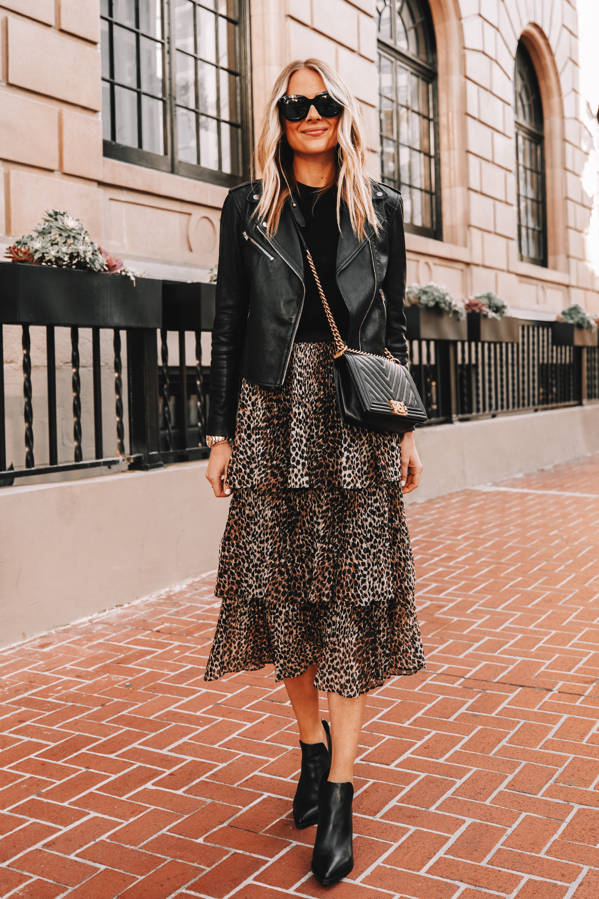 Fashion Jackson Wearing Black Leather Jacket Black Sweater Topshop Leopard Tiered Midi Skirt Black Booties