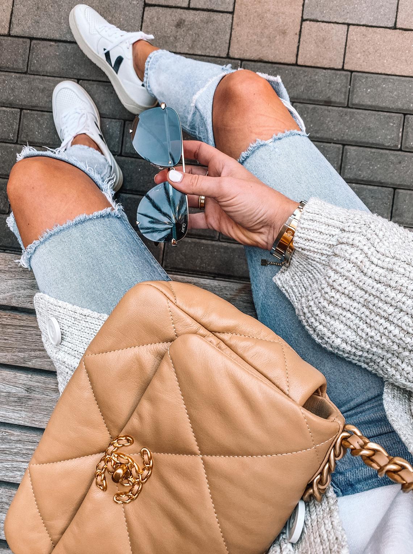 Fashion Jackson Wearing Boyish Ripped Jeans Veja Sneakers Knit Cardigan Chanel 19 Beige Handbag Aviator Sunglasses