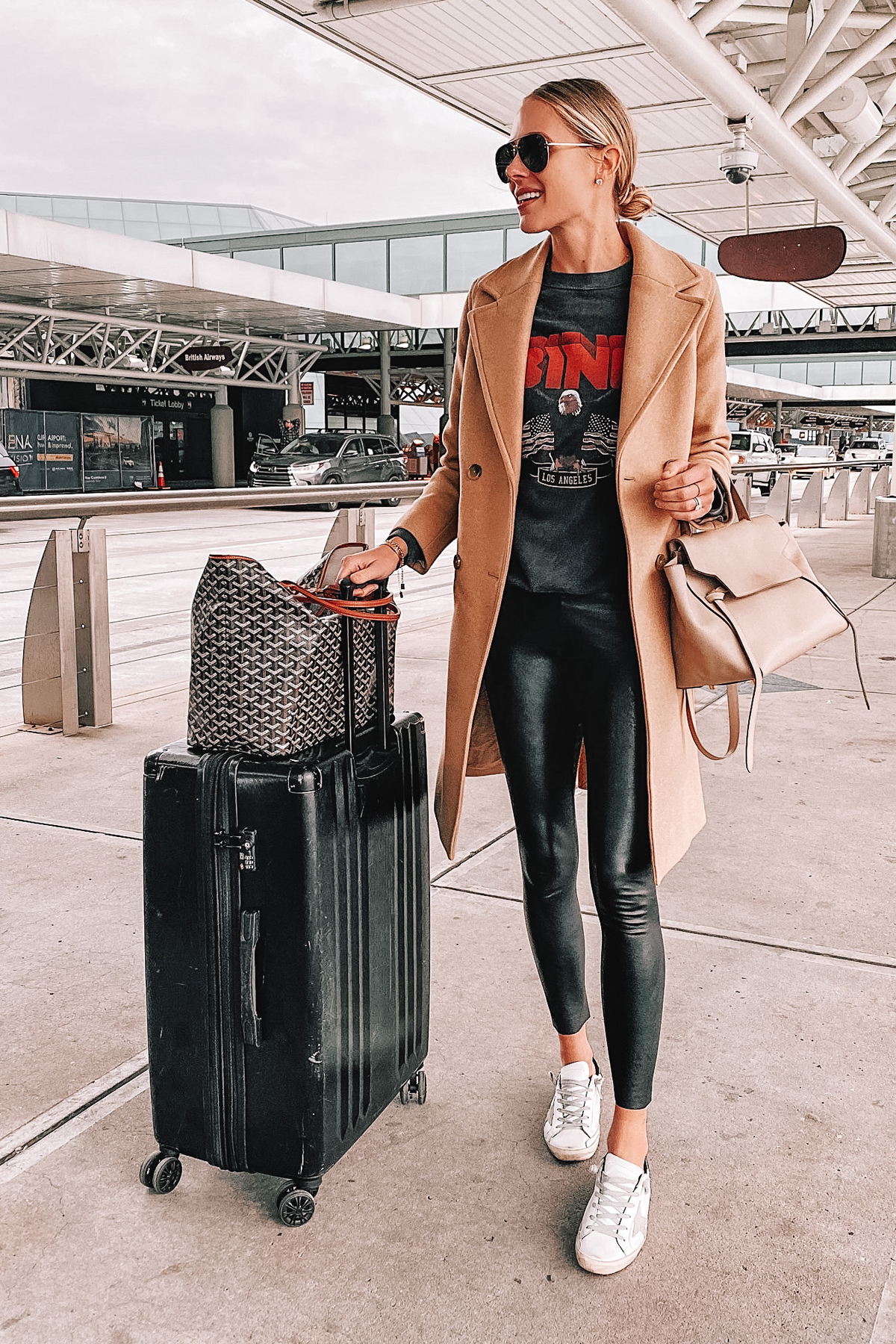 Fashion Jackson Wearing Camel Coat Anine Bing Sweatshirt Spanx Faux Leather Leggings Golden Goose Sneakers Calpak Luggage Airport Style Travel Outfit