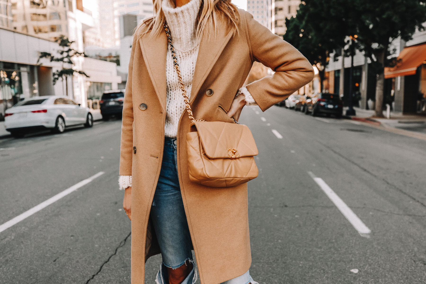 Fashion Jackson Wearing Everlane Camel Coat White Chunky Sweater Ripped Jeans Chanel 19 Small Beige Handbag