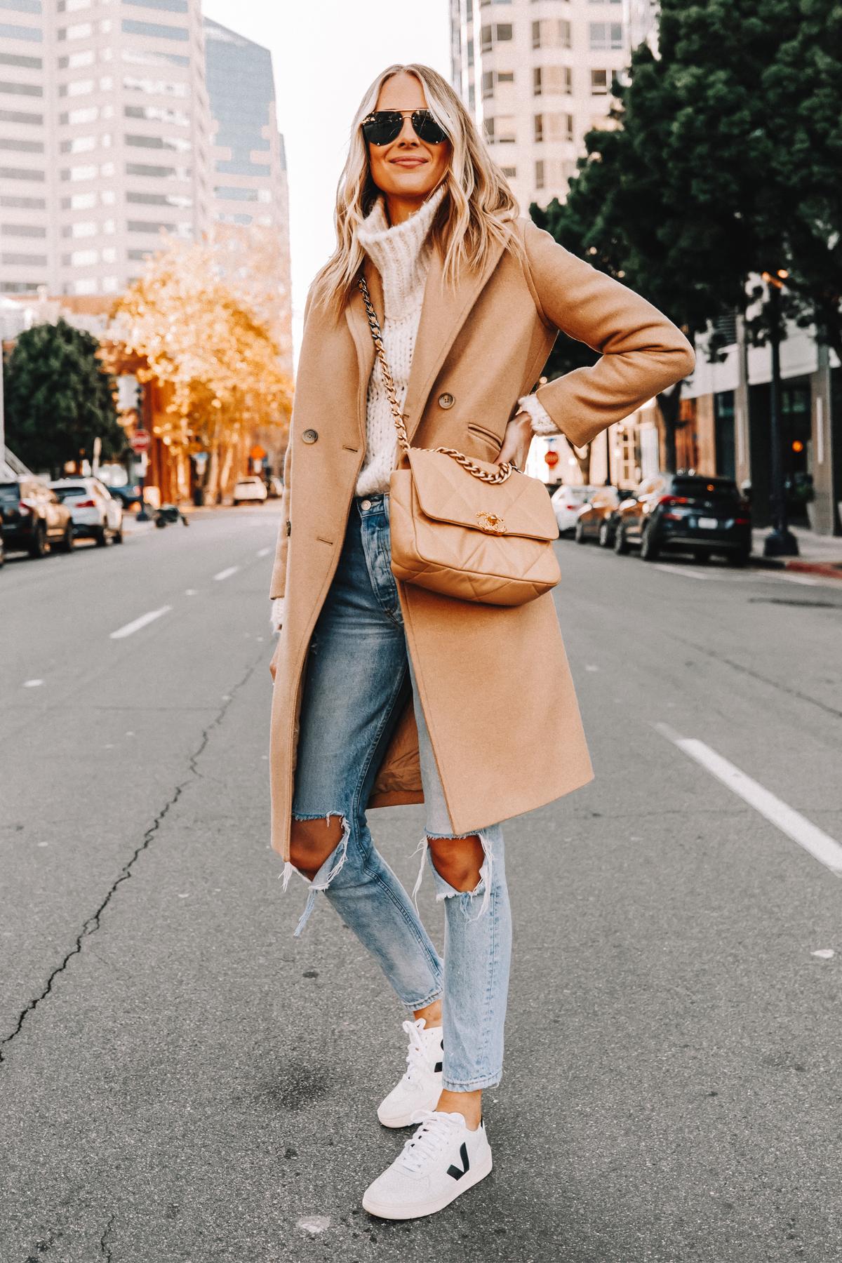Fashion Jackson Wearing Everlane Camel Coat White Chunky Turtleneck Sweater Ripped Jeans Veja V10 Sneakers Chanel 19 Beige Handbag