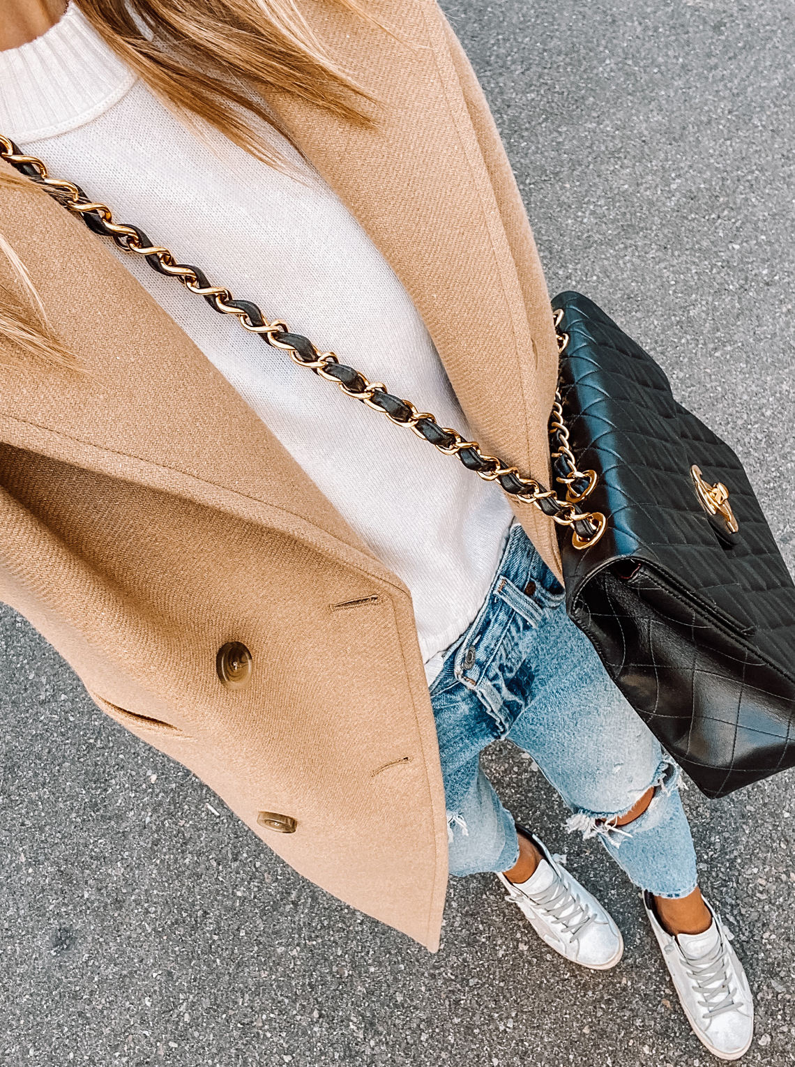 Fashion Jackson Wearing Everlane Camel Coat White Sweater Ripped Levis Jeans Golden Goose Sneakers Chanel Quilted Jumbo XL Handbag