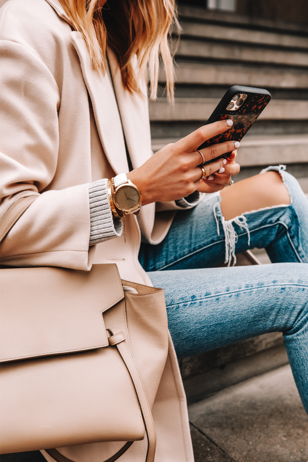 Fashion Jackson Wearing Garmin Vivomove Luxe Watch White Beige Coat Ripped Levis Jeans Celine Belt Bag