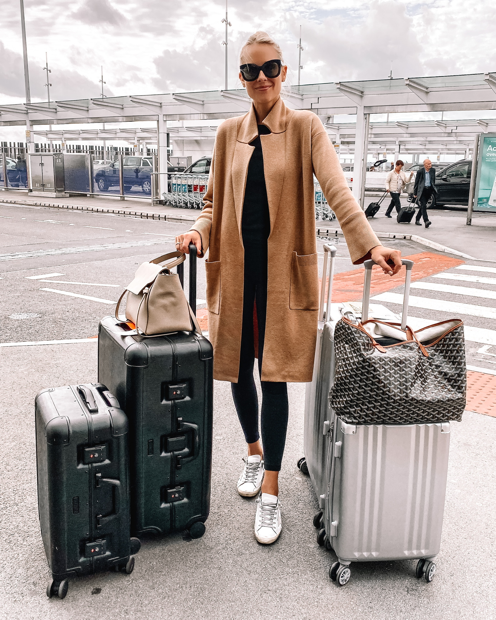 Fashion Jackson Wearing Camel Coatigan Black Leggings Golden Goose Sneakers Calpak Luggage Goyard Tote Airport Outfit Travel Style