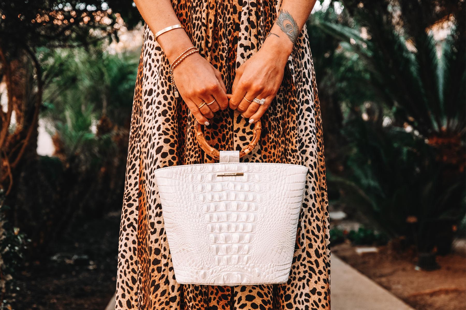 Fashion Jackson Holding Brahmin Mod Bowie Handbag in White 1