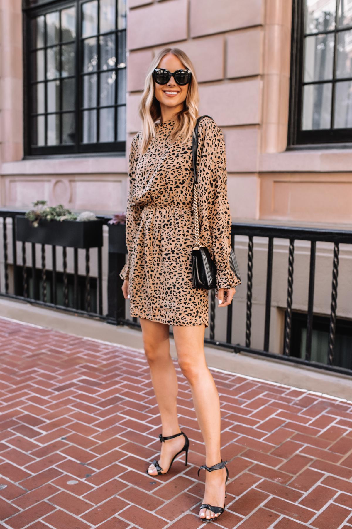 Fashion Jackson Wearing Baum und Pferdgarten Aemiley Drape Leopard Mini Dress Black Heeled Sandals Black Handbag 1